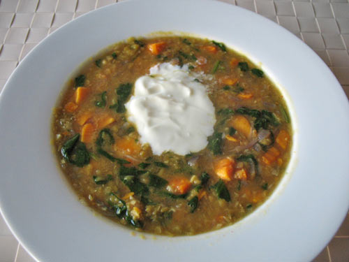 Red lentil soup with sweet potato and spinach