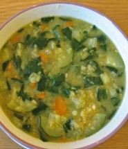 Red lentil soup with spinach and courgettes