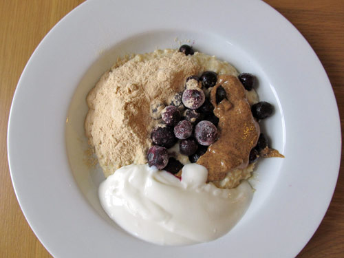 Baobab porridge with blueberries, almond butter and natural yoghurt