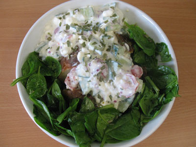 Jacket potato with cottage cheese salad and spinach
