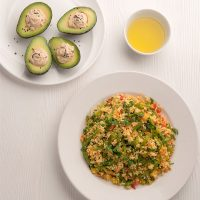 Warm millet salad and avocado stuffed with hummus (vegan + gluten-free)