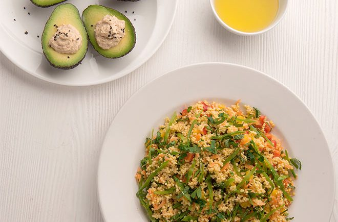 Warm millet salad and avocado stuffed with hummus