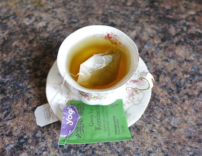 Yogi Green Tea Kombucha in a teacup