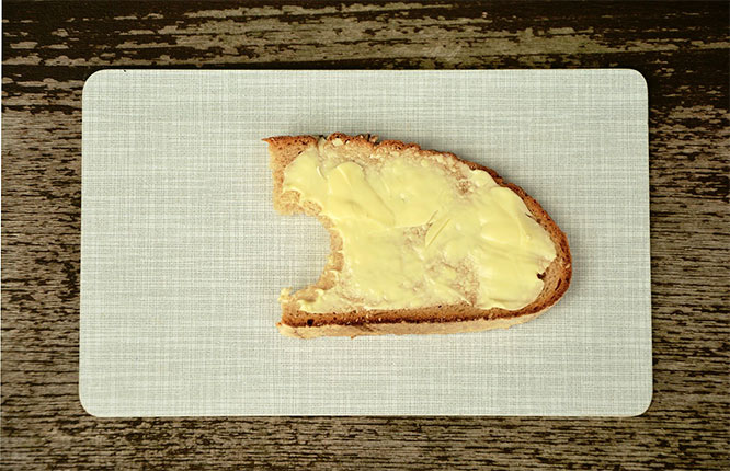 butter on a piece of bread
